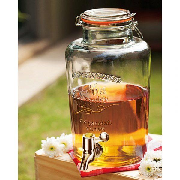 Glassdispenser på 6 liter med tappekran. Forfriskninger til gjester i denne glass dispenseren. Drikkedispenser.