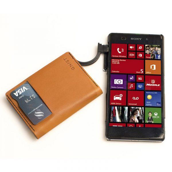 Gnist - Lommebok og batteribank til iPhone eller Android telefon.
